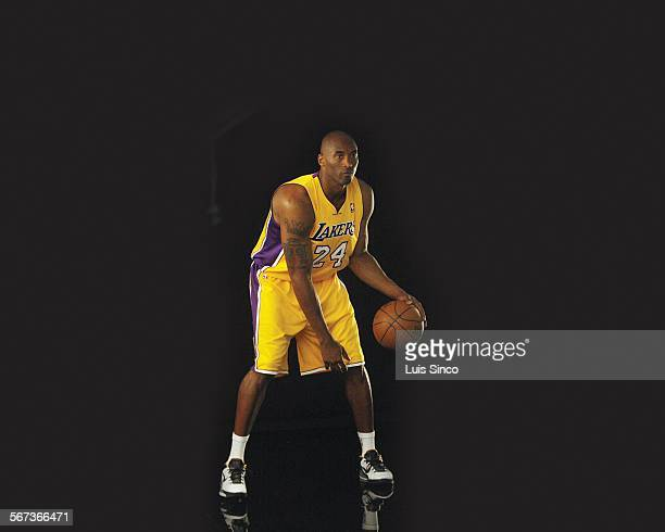 The Los Angeles Lakers' Kobe Bryant handles the ball for a photo shoot during the team's media day at their El Segundo California training facility...
