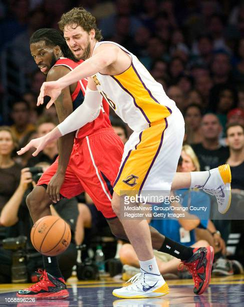 The Los Angeles Lakers' Pau Gasol is fouled by the Atlanta Hawks' DeMarre Carroll at Staples Center in Los Angeles CA on November 2 2013