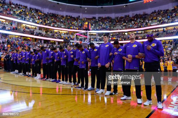 The Los Angeles Lakers players lock arms during the national anthem before the start of the game against the Minnesota Timberwolves on September 30,...