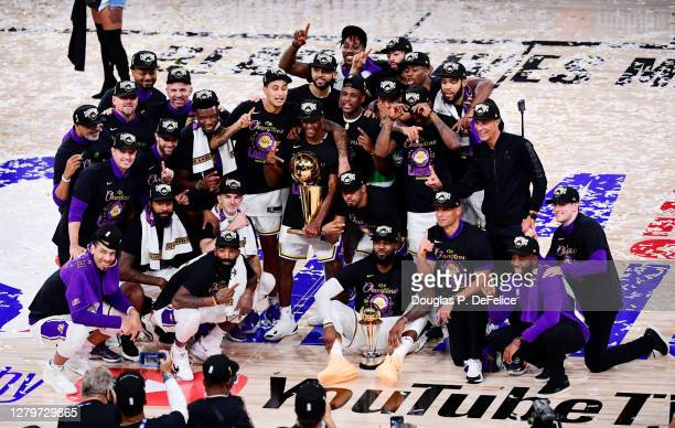 The Los Angeles Lakers pose for a team photo with the trophy after winning the 2020 NBA Championship over the Miami Heat in Game Six of the 2020 NBA...