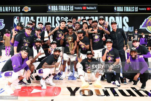 The Los Angeles Lakers poses for a team photo together with the Larry O'Brien Trophy after Game Six of the NBA Finals on October 11, 2020 at...