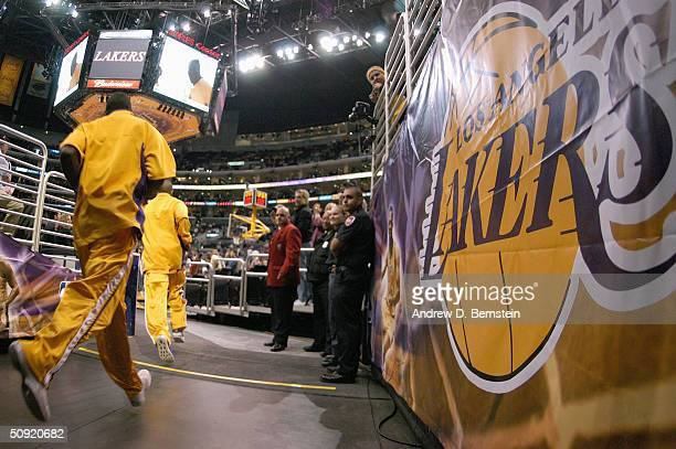 The Los Angeles Lakers run out of the tunnel before Game three of the Western Conference Finals during the 2004 NBA Playoffs against the Minnesota...