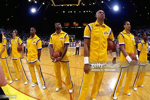 The Los Angeles Lakers stand for the national anthem against the Detroit Pistons during Game Two of the 1988 NBA Finals on June 9 1988 at the Great...