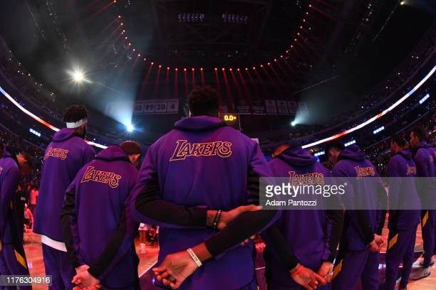 The Los Angeles Lakers stand for the National Anthem prior to a preseason game against the Golden State Warriors on October 16 2019 at STAPLES Center...