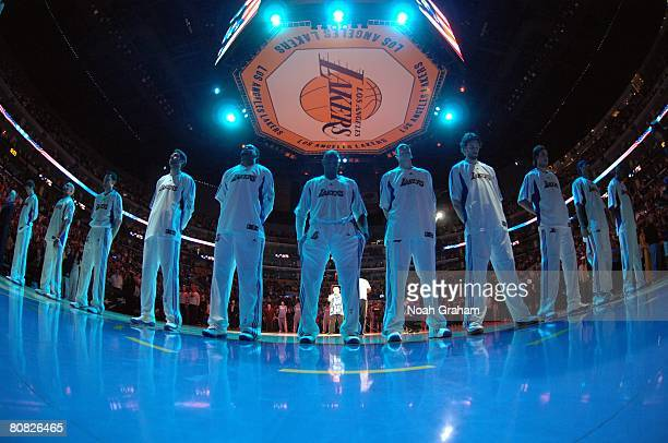 The Los Angeles Lakers stand for the national anthem prior to Game One of the Western Conference Quarterfinals against the Denver Nuggets during the...