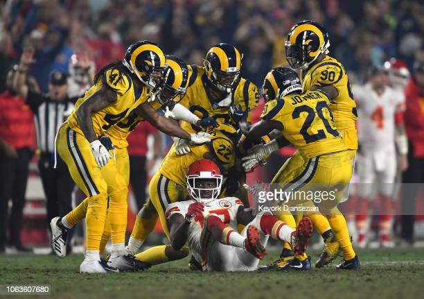 The Los Angeles Rams celebrate after teammate Marcus Peters intercepts the ball intended for Chris Conley of the Kansas City Chiefs during the fourth...