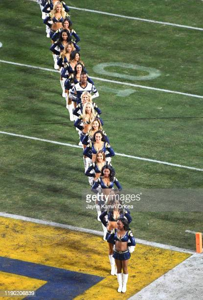 The Los Angeles Rams cheerleaders line up for players to run on to the field for the game against the Baltimore Ravens at the Los Angeles Memorial...