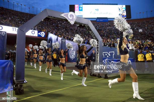 The Los Angeles Rams Cheerleaders run onto the field prior to the NFC Wild Card Playoff Game against the Atlanta Falcons at the Los Angeles Coliseum...
