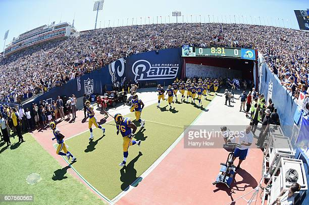 The Los Angeles Rams enter the field before their home opening NFL game against the Seattle Seahawks at Los Angeles Coliseum on September 18 2016 in...