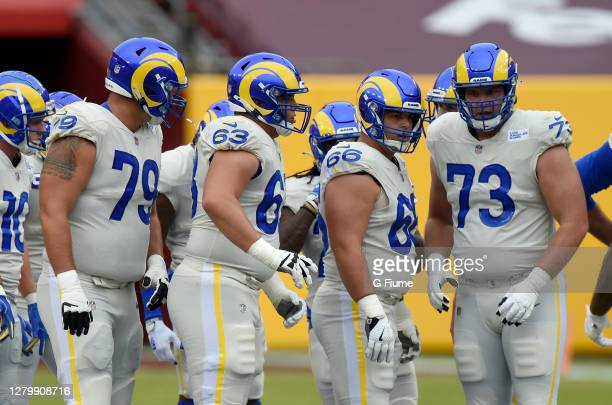 The Los Angeles Rams huddle up during the game against the Washington Football Team at FedExField on October 11, 2020 in Landover, Maryland.