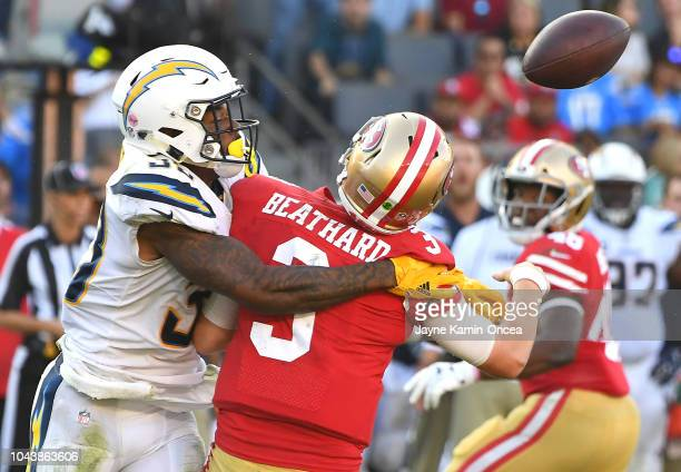 The Los Angeles Rams recover a fumble forced by defensive back Derwin James of the Los Angeles Chargers as he sacks quarterback CJ Beathard of the...