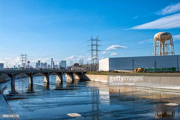 The Los Angeles River with the Vernon water tower and the Los Angeles skyline in the background, California.