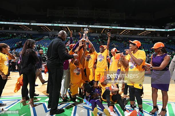 The Los Angeles Sparks and Owner Magic Johnson celebrate after winning Game Five of the 2016 WNBA Finals against the Minnesota Lynx on October 20,...