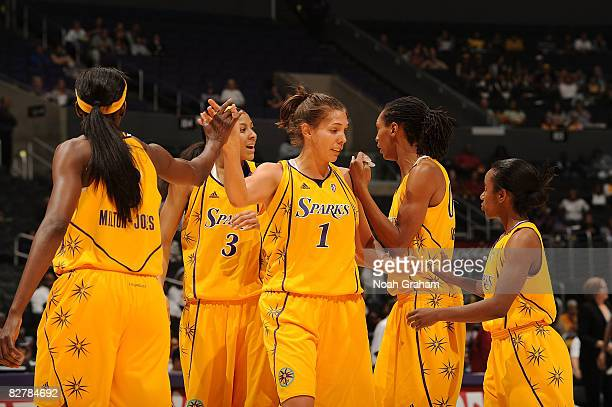 The Los Angeles Sparks celebrate on the court during the game against the Atlanta Dream on September 11, 2008 at Staples Center in Los Angeles,...