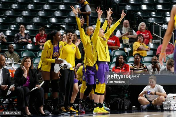 The Los Angeles Sparks celebrates during the game against the Indiana Fever on August 29 2019 at the Bankers Life Fieldhouse in Indianapolis Indiana...