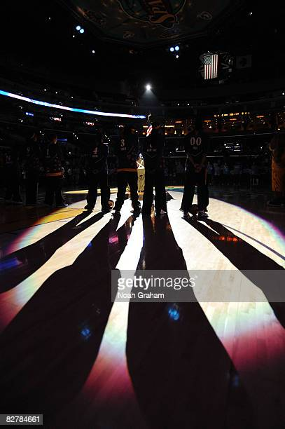 The Los Angeles Sparks stand on the court during the singing of the National Anthem before the game against the Atlanta Dream on September 11, 2008...