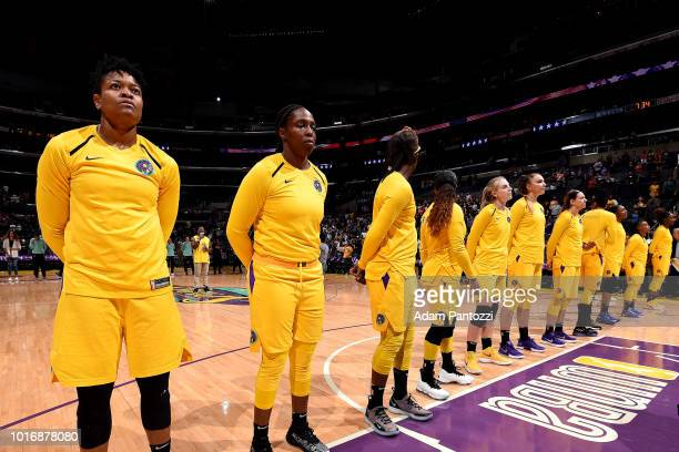 The Los Angeles Sparks stands for the National Anthem before the game against the New York Liberty on August 14 2018 at Staples Center in Los Angeles...