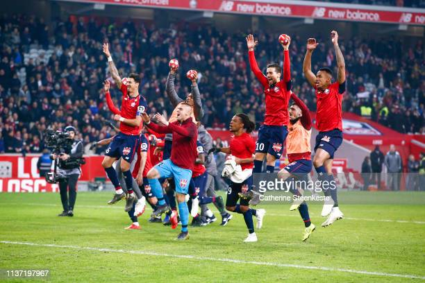 The Losc team celebrates the victory of the Ligue 1 match between Paris SaintGermain and Lille OSC at Stade Pierre Mauroy on April 14 2019 in Lille...