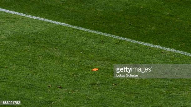The lost red card of referee Felix Zwayer lies on the pitch during the Bundesliga match between FC Schalke 04 and Borussia Dortmund at VeltinsArena...