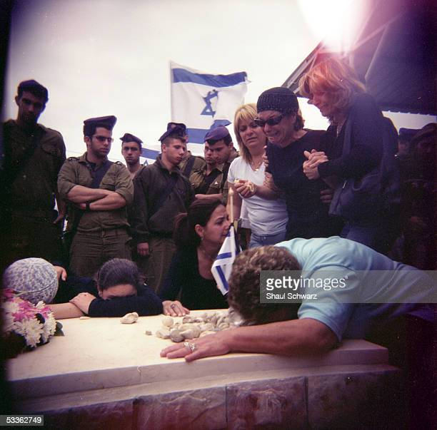 The Lottati family weeps over the grave of Israel Lottati at the yearly day of remembrance for fallen IDF solders in the cemetery of the Gush Katif...