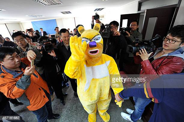 The lottery winner comes to lottery center to cash RMB 520 million yuan by wearing a cartoon costume on 13th October 2014 in Shanxi China This is the...