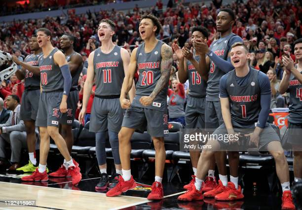The Louisville Cardinals bench celebrates during the game against the Pittsburgh Panthers at KFC YUM Center on December 06 2019 in Louisville Kentucky