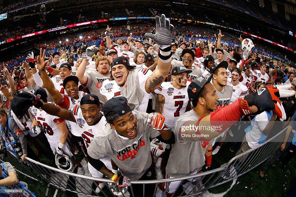 The Louisville Cardinals celebrate their 33 to 23 win over the Florida Gators during the Allstate Sugar Bowl at Mercedes-Benz Superdome on January 2, 2013 in New Orleans, Louisiana.