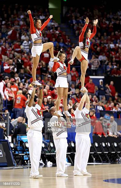 The Louisville Cardinals cheerleaders perform during a game stoppage in the first half against the Colorado State Rams during the third round of the...