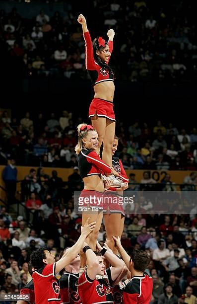 The Louisville Cardinals' cheerleaders perform during a stoppage in time against the Georgia Tech Yellow Jackets in the second round of the NCAA...