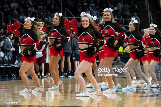 The Louisville Cardinals Cheerleaders perform during the second half of the game between the Connecticut Huskies and the Louisville Cardinals on...