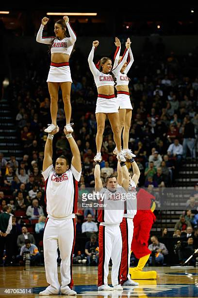 The Louisville Cardinals cheerleaders perform on the court during a timeout in the first half against the UC Irvine Anteaters during the second round...