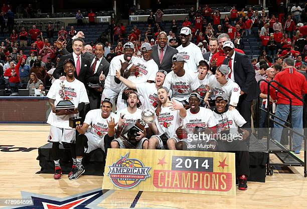 The Louisville Cardinals pose with the championship trophy after defeating the Connecticut Huskies during the Championship of the American Athletic...
