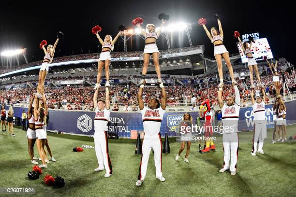 The Louisville cheerleaders perform during the second half of the Camping World Kickoff game between Alabama and Louisville on September 01 at...