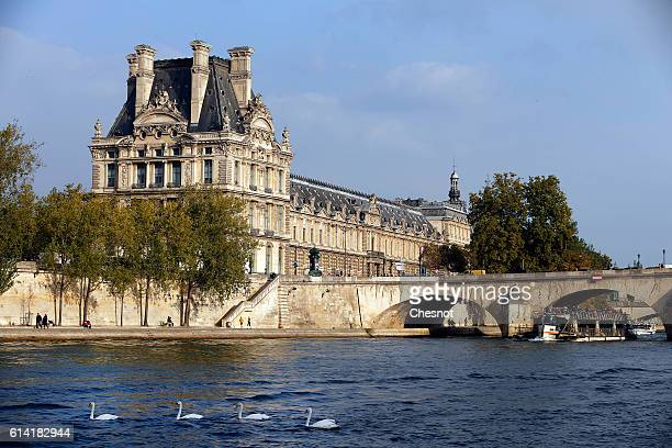 The Louvre museum is seen from a boat on the river Seine on October 12 2016 in Paris France The city of Paris remains the a top tourist destination...
