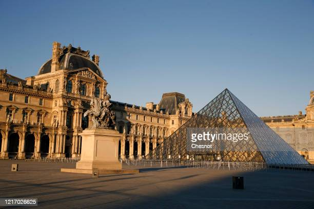 """The Louvre Museum, the Louvre Pyramid and the """"Cour Carree"""" at sunset is closed until further notice during the coronavirus epidemic on April 5 in..."""