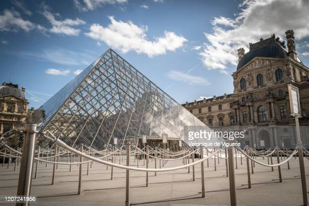 The Louvre Museum, which was closed yesterday at 6pm, stands empty on March 15, 2020 in Paris, France. French President Emmanuel Macron has declared...
