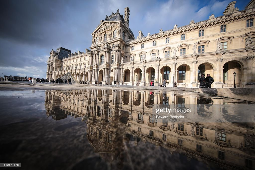 The Louvre Palace reflecting into a water puddle, on February 7, 2016 in the 1st quarter of Paris, France.