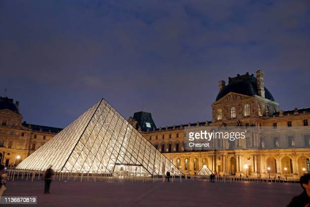 The Louvre Pyramid and the Louvre museum are seen at night on March 18, 2019 in Paris, France. The pyramid of the Louvre Museum celebrates its 30th...
