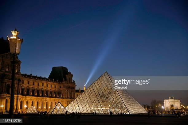 The Louvre Pyramid and the Louvre museum are seen at night on March 21, 2019 in Paris, France. The pyramid of the Louvre Museum celebrates its 30th...