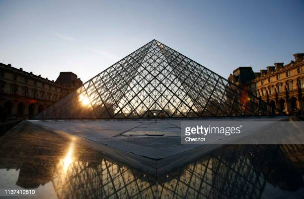 The Louvre Pyramid and the Louvre museum are seen on March 21, 2019 in Paris, France. The pyramid of the Louvre Museum celebrates its 30th...