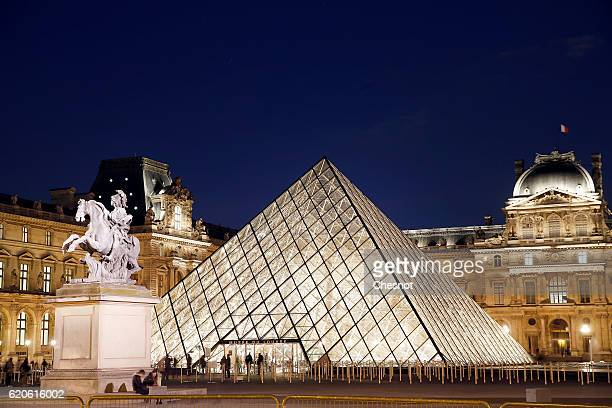 The Louvre Pyramid and the Louvre museum by night are seen on November 02 2016 in Paris France The city of Paris remains the top tourist destination...