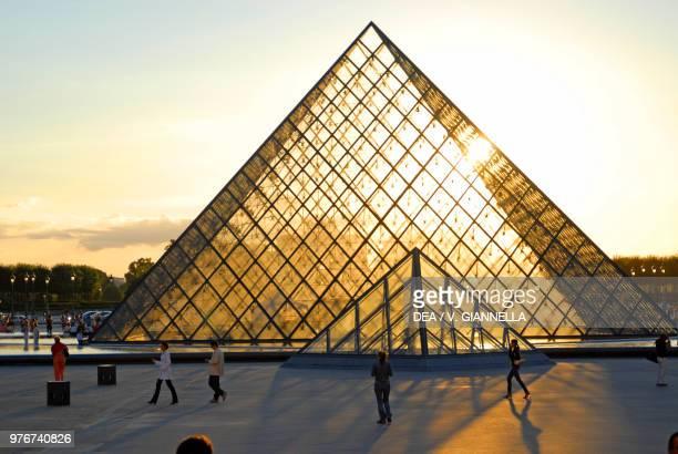 The Louvre pyramid at sunset, Paris , France.