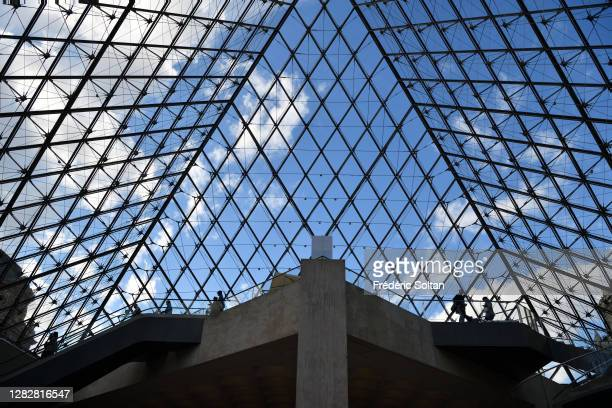 The Louvre Pyramid , designed by the architect I. M. Pei, surrounded by three smaller pyramids, in the main courtyard of the Louvre Palace in Paris...