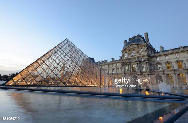 The Louvre Pyramid in Paris. The Louvre Pyramid is a large glass and metal pyramid designed by the architect I. M. Pei, surrounded by three smaller...