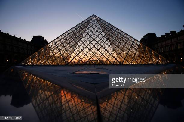 The Louvre Pyramid is seen at sunset on March 21, 2019 in Paris, France. The pyramid of the Louvre Museum celebrates its 30th anniversary. Designed...