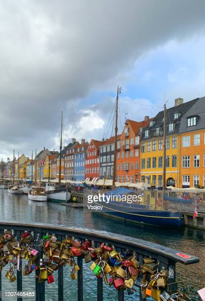 the love locks at the nyhavn harbour, copenhagen, denmark - vsojoy stock pictures, royalty-free photos & images