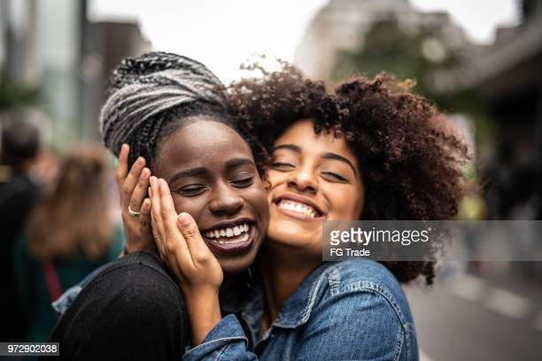 the love of best friends - beautiful black teen girl stock photos and pictures