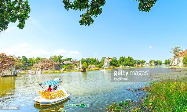 the lovers relaxing on a swan boat - pedal boat stock pictures, royalty-free photos & images