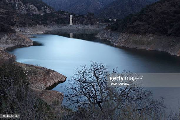 The low water level of Morris Reservoir is seen before dawn on the San Gabriel River in the Angeles National Forest on January 22 2014 in near Azusa...