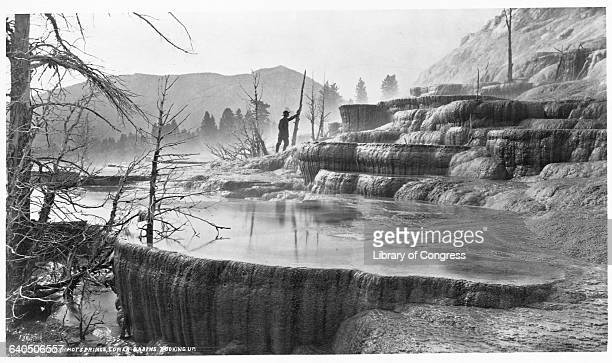 The lower basin of Mammoth Hot Springs, in Yellowstone National Park, 1870-1879.